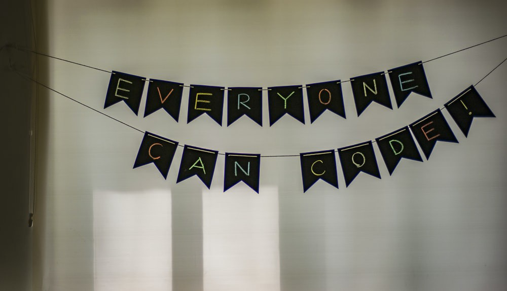 "A banner saying ""everyone can code"""