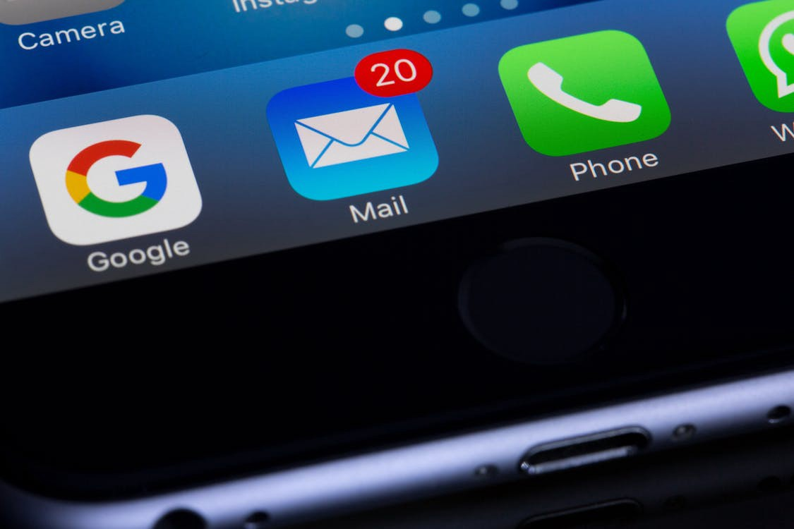 A close up of an iPhone screen showing 20 new emails in the inbox