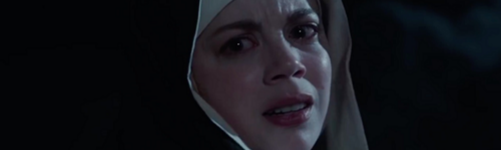 the face of a nun, frightened and anguishing in the night