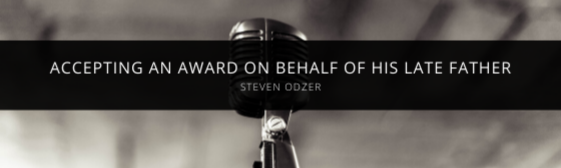 Steven Odzer accepts award