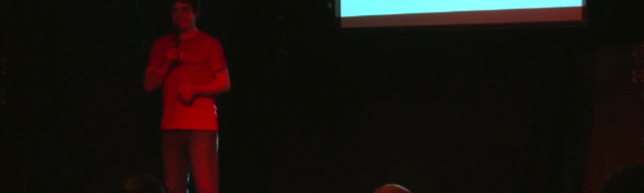 Me, speaking on stage about philosophy, science and brewing coffee