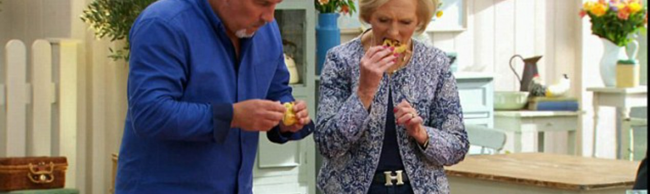 Paul Hollywood and Mary Berry tasting technical bakes from British Bake Off.