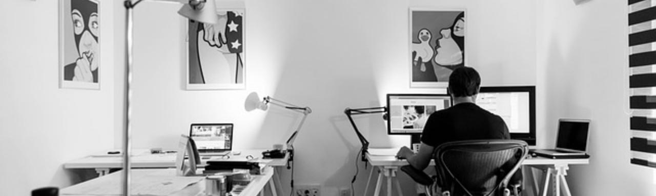 web designer in the office facing a computer