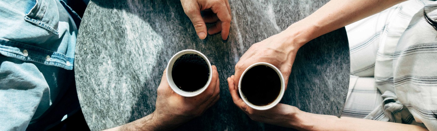 Image of two meeting meeting for coffee