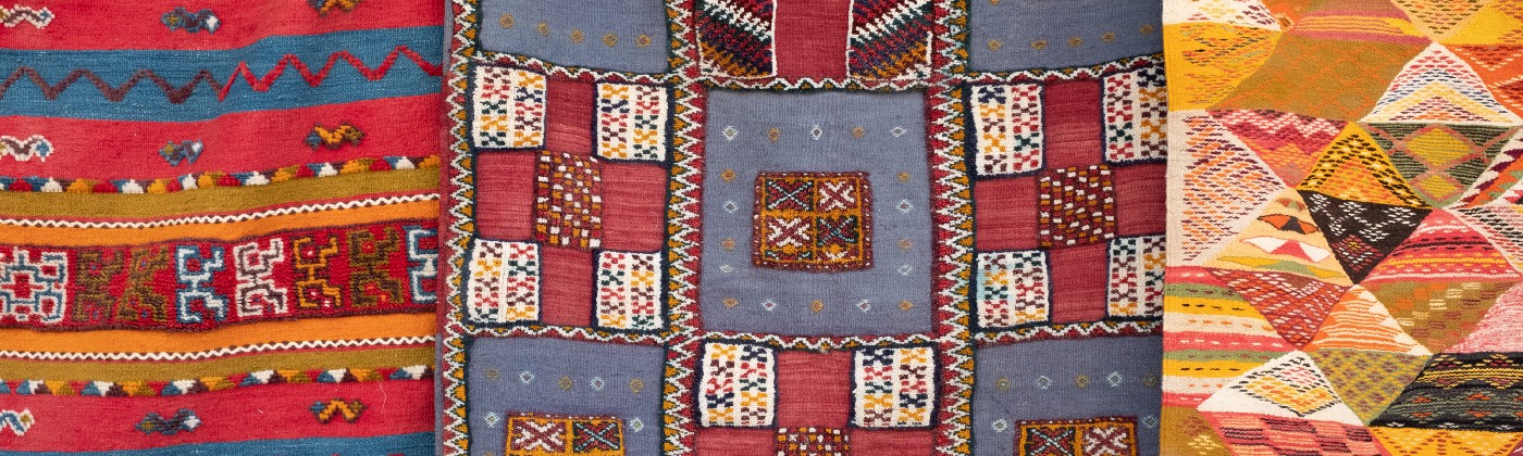 Three distinct patches of a quilt stitched together.