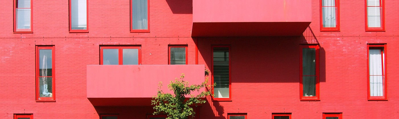 A picture of a building paint in all red