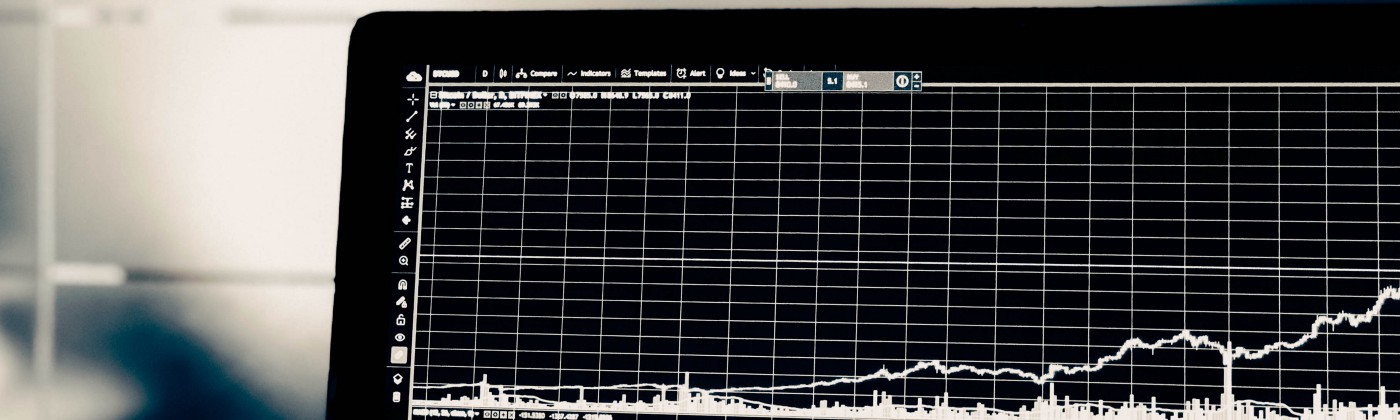 Screen with a trading chart on it.