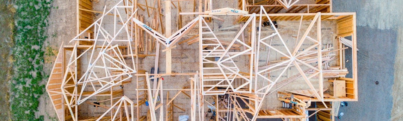 An arial view of a wooden house frame under construction