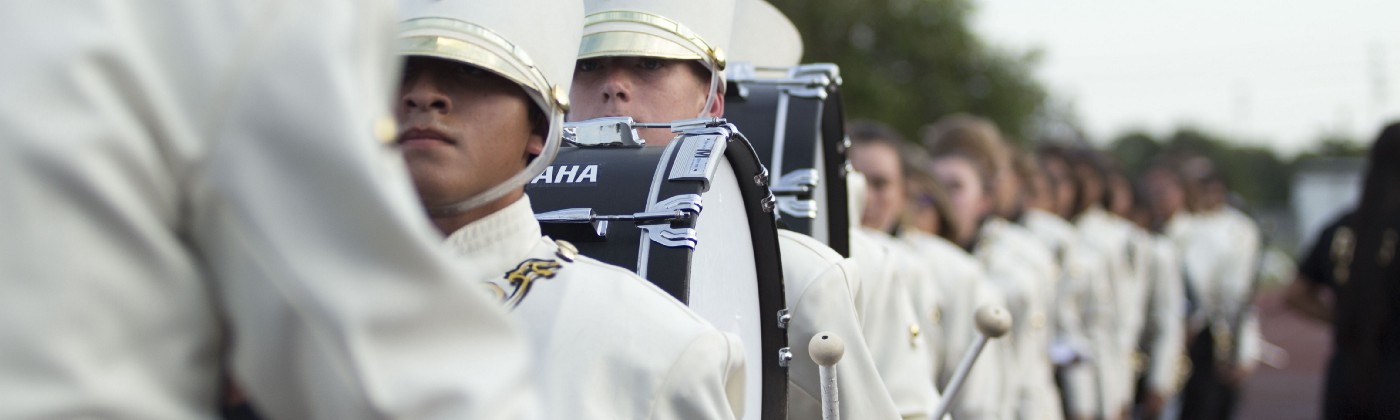 marching band with white uniforms