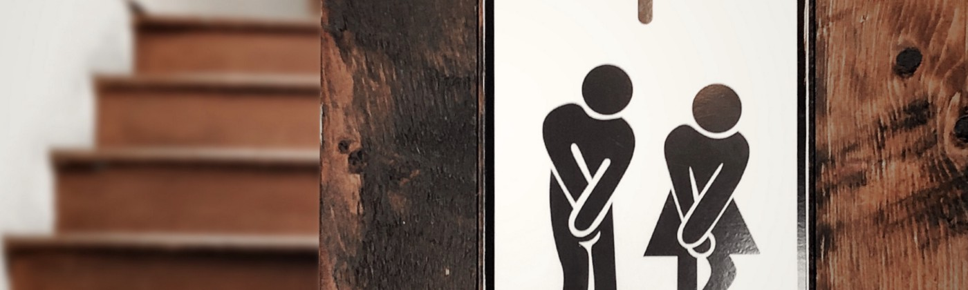 Male and female illustrations, indicating they need to use the bathroom