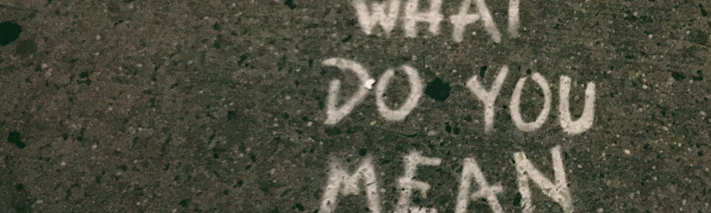 What do you mean? written on pavement