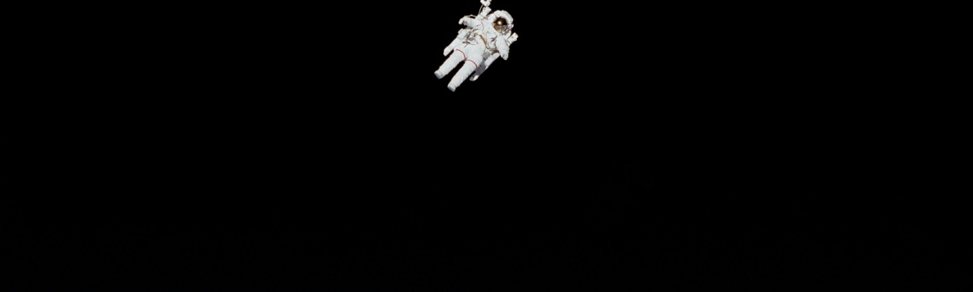 An astronaut drifting off in space