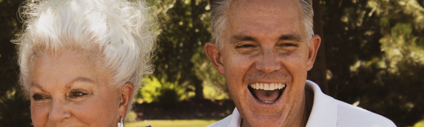 Old, healthy, man and woman smiling.