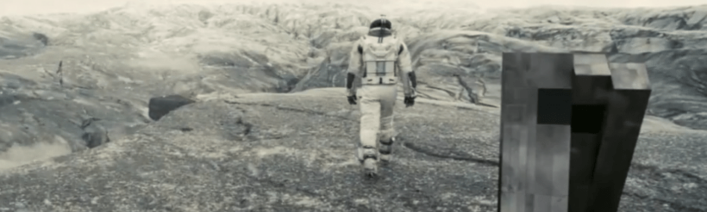 "Astronaut and robot cooperate in the film ""Interstellar."""