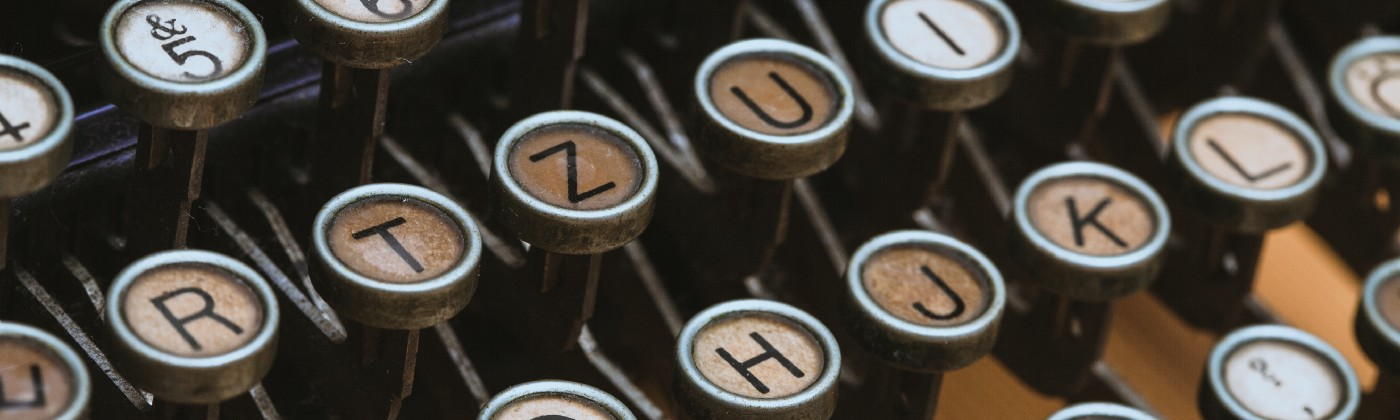 Close up of the keys on an antique typewriter.