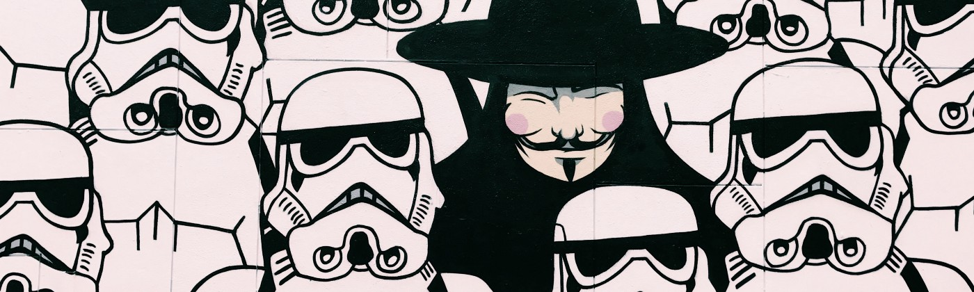 Star Wars storm troopers with man in Guy Fawkes mask among them