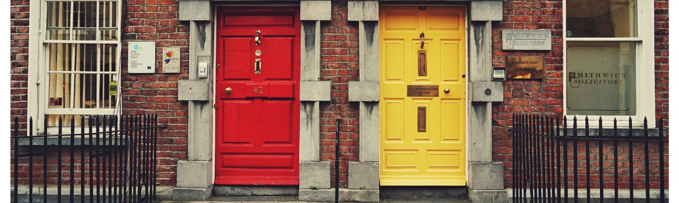 Two doors, one yellow and one red, give the viewer a choice.