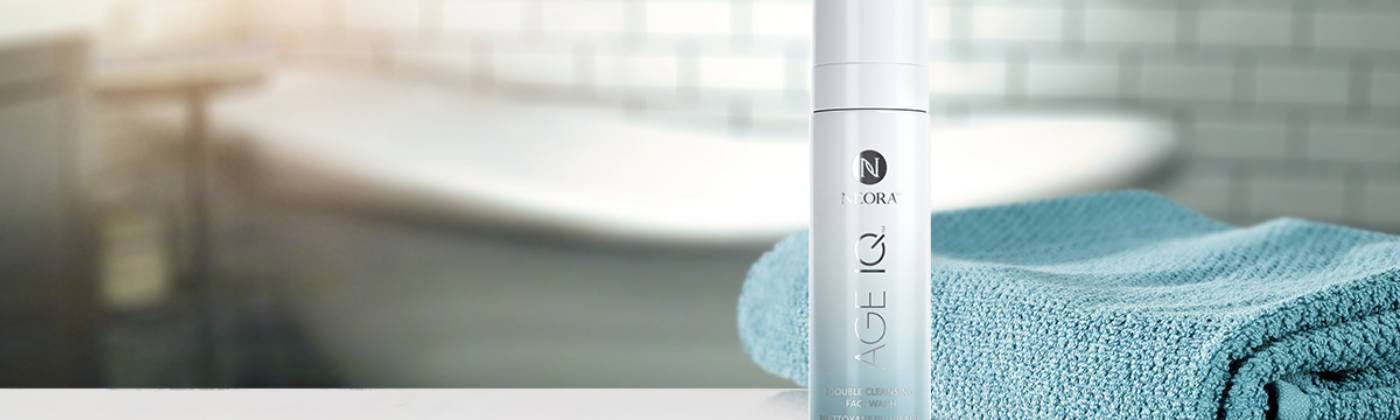 A bottle of Neora's Double-Cleansing Botanical Face Wash.