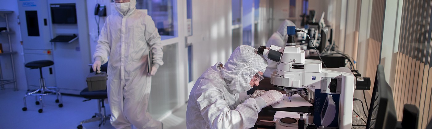 Singh Center researchers work in head-to-toe cleanroom suits.