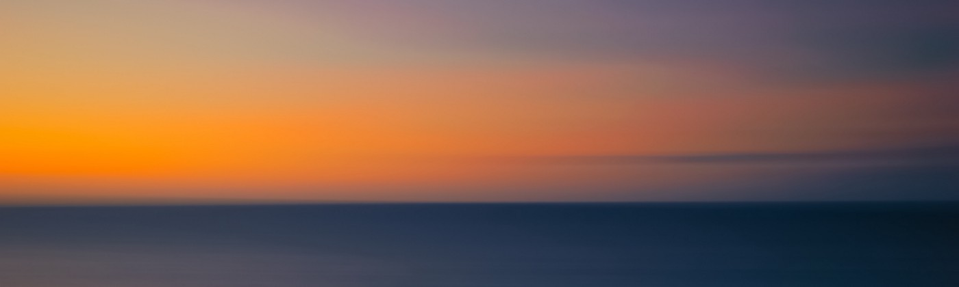 Blurred, abstact scene of ocean at sunset