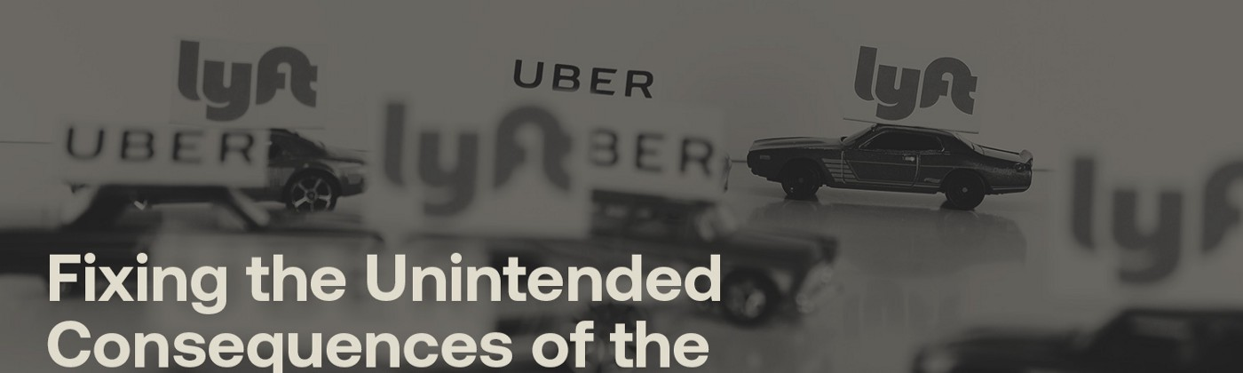 Model cars with Uber and Lyft ads on them