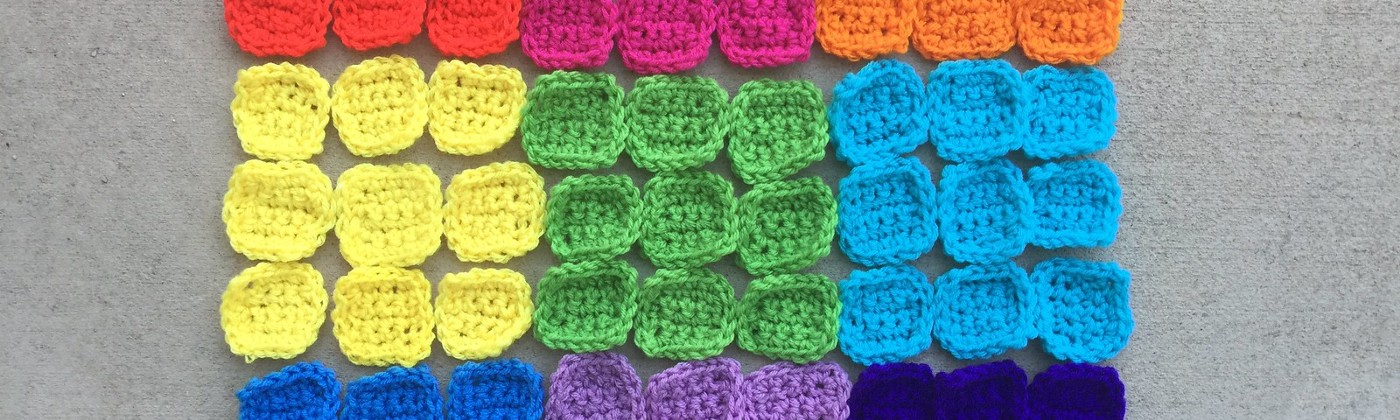 Eighty-one crochet squares to be used to solve a crochet sudoku puzzle
