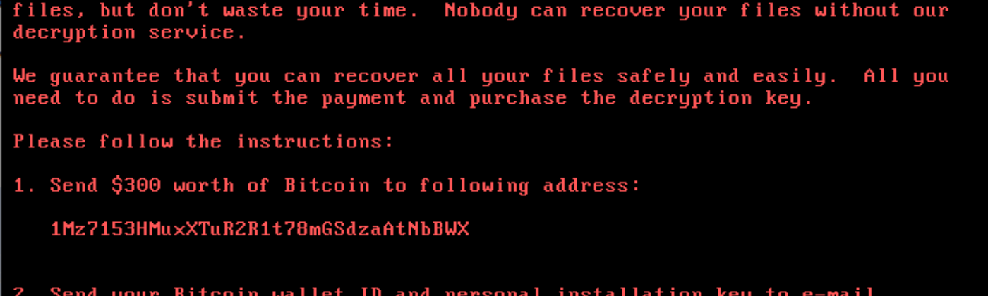 A screen image captured from a computer infected with NotPetya ransomware, extorting the user for Bitcoins to decrypt files.