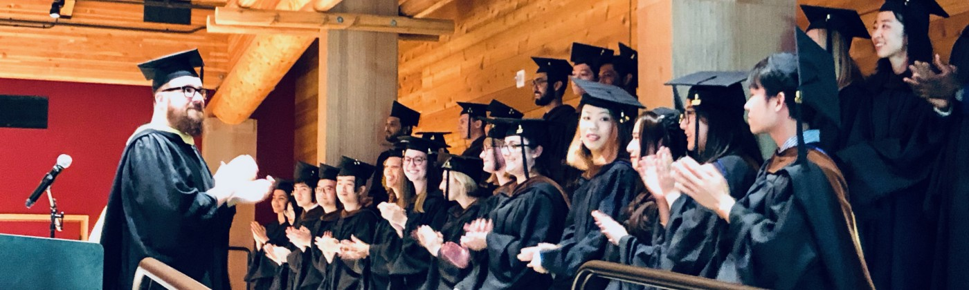 A photograph of the standing 2019 graduating class of the MHCI+D program