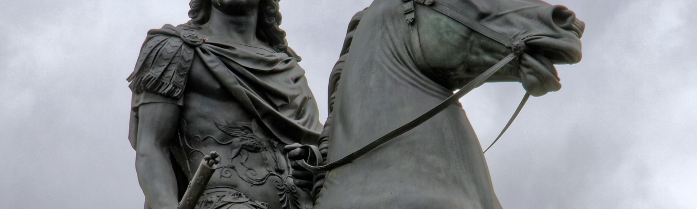 Statue of King Louis XIV on a horse with a red blindfold over his eyes. Taken in Paris, France.