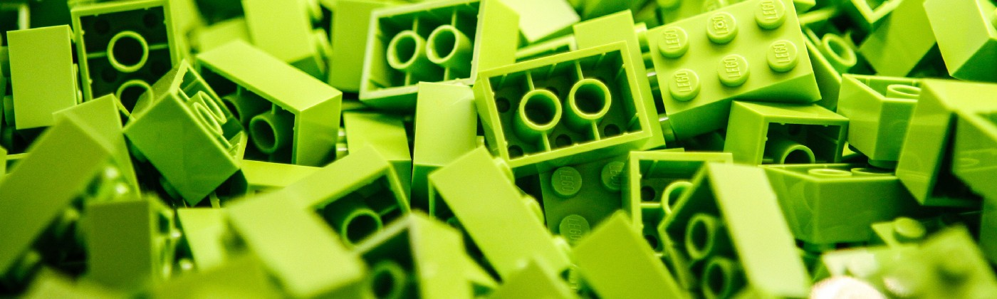 A pile of lime green lego blocks.