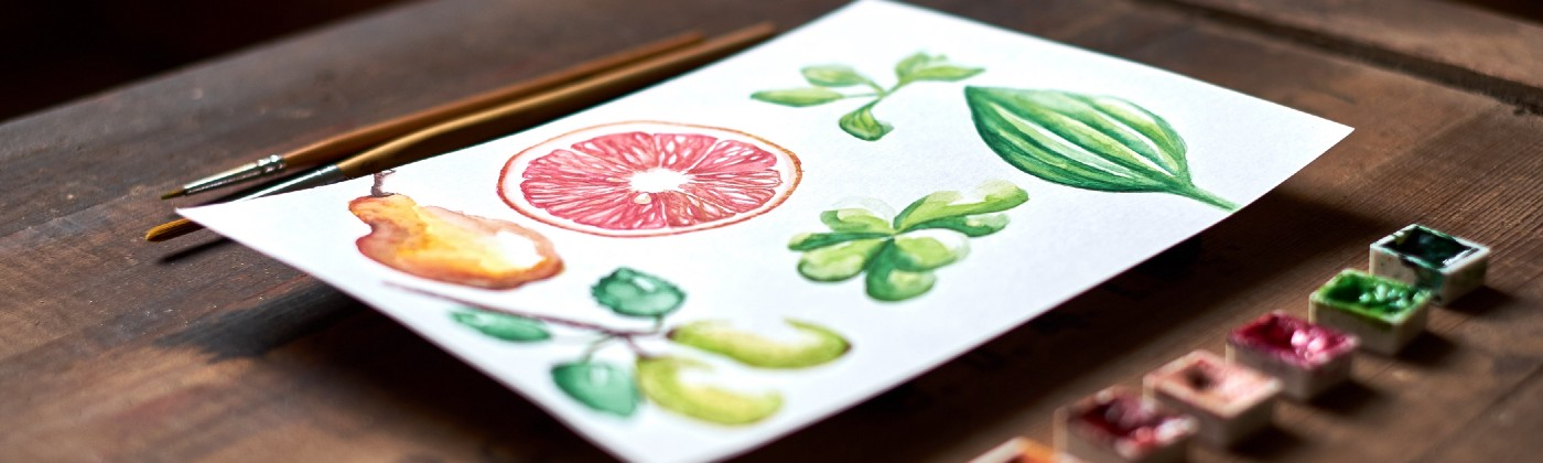 small freshly painted watercolor painting of fruit, paint, brushes