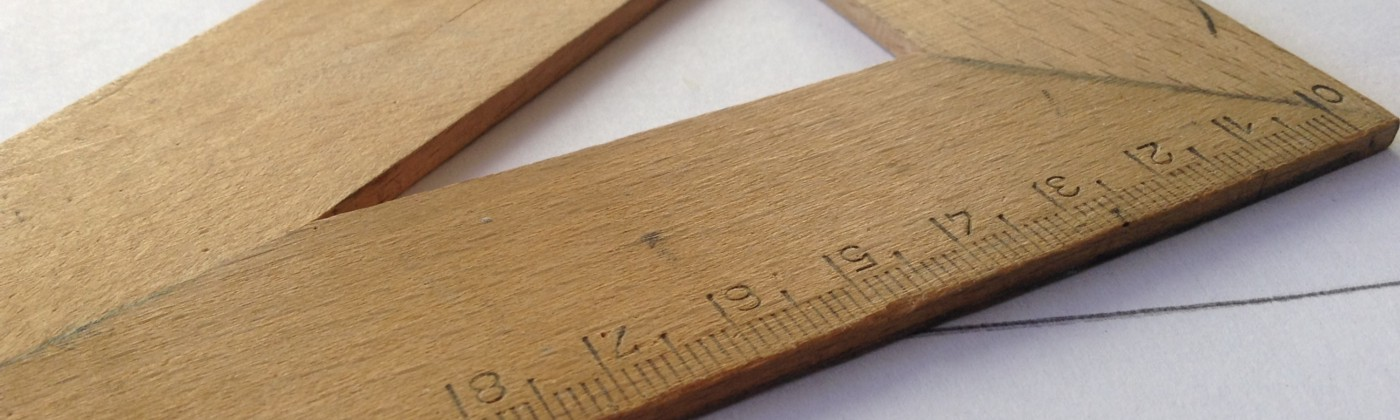 An image of a measuring wooden triangle that depicts the manual art of problem solving