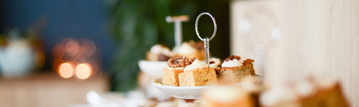 small cakes on tiered stands against a blurred background
