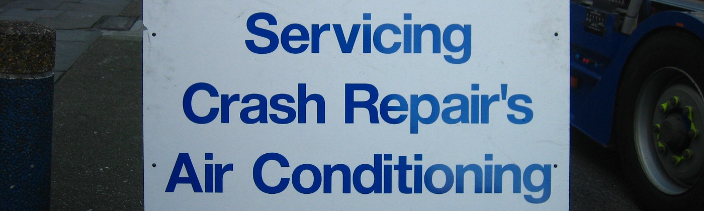 Garage sign containing inappropriate apostrophes.