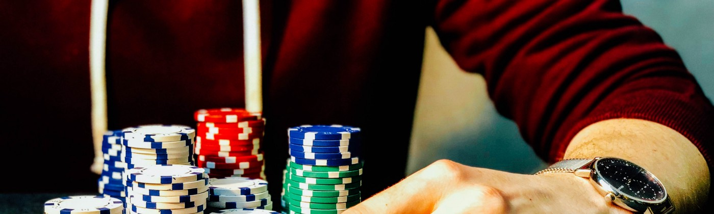 Man playing poker—Life is a game and we are all gamblers