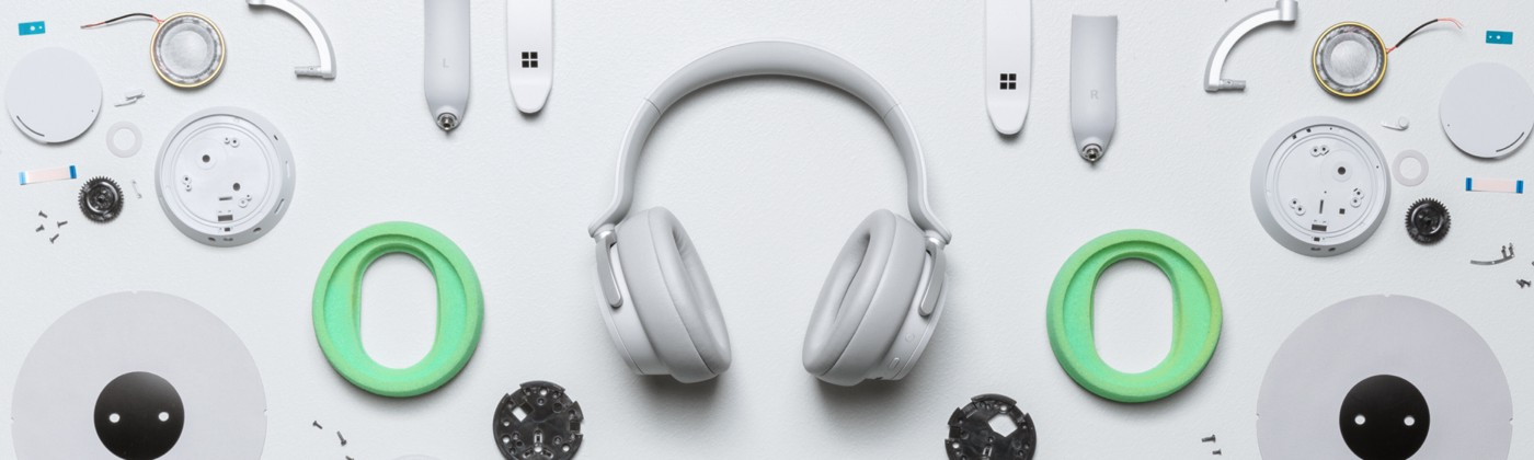 Varying headphone pieces in a scattered array.