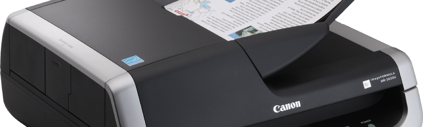image of a desktop scanner with a piece of paper in the feed tray