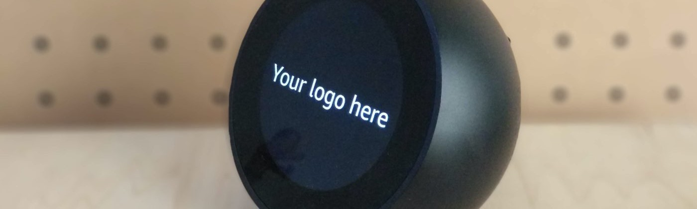 """Alexa Echo Spot with the text on the screen """"Your logo here"""""""