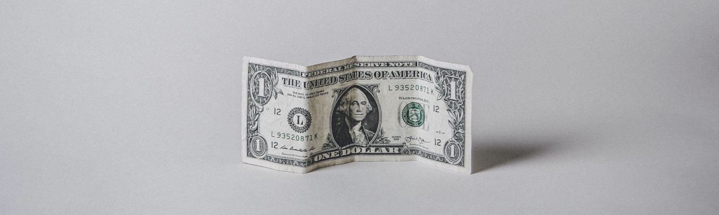 dollar note standing on a grey background