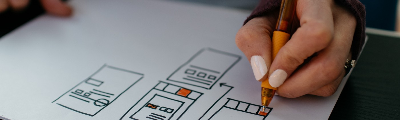 Image of a hand drawing wireframes