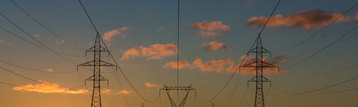 Picture of transmission lines and power towers at sunset