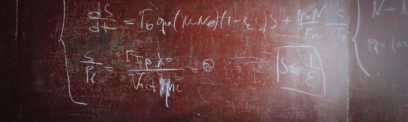 Mathematical equations written in chalk.