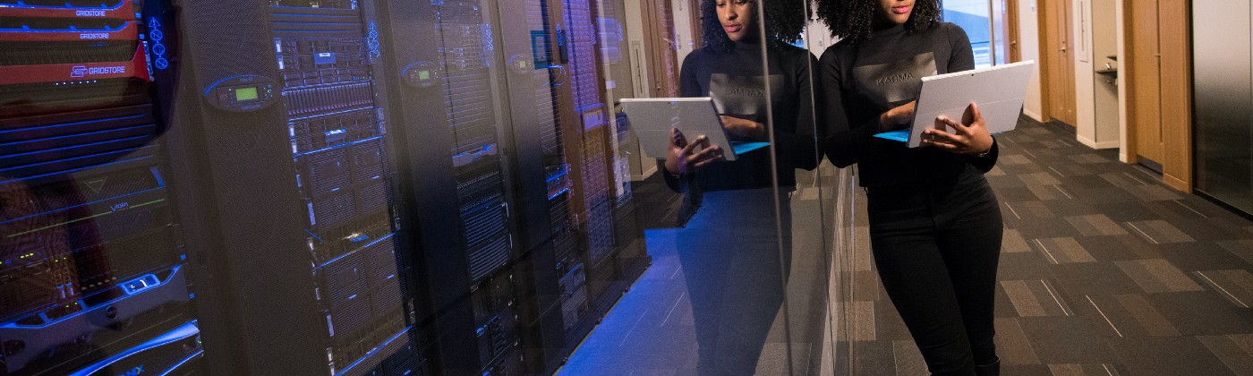 Woman holding laptop in a serverroom