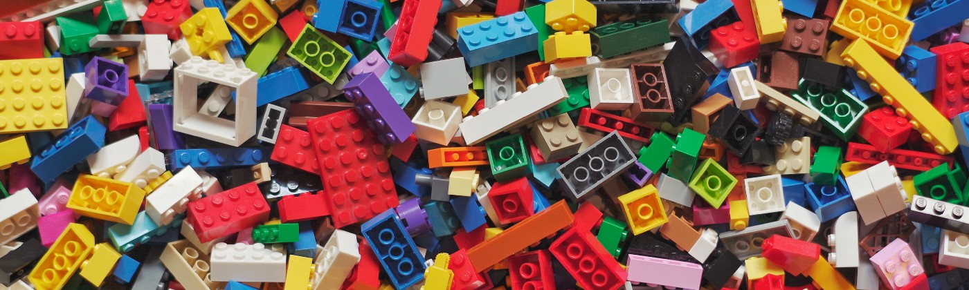 A lot of small, colorful lego pieces spread around