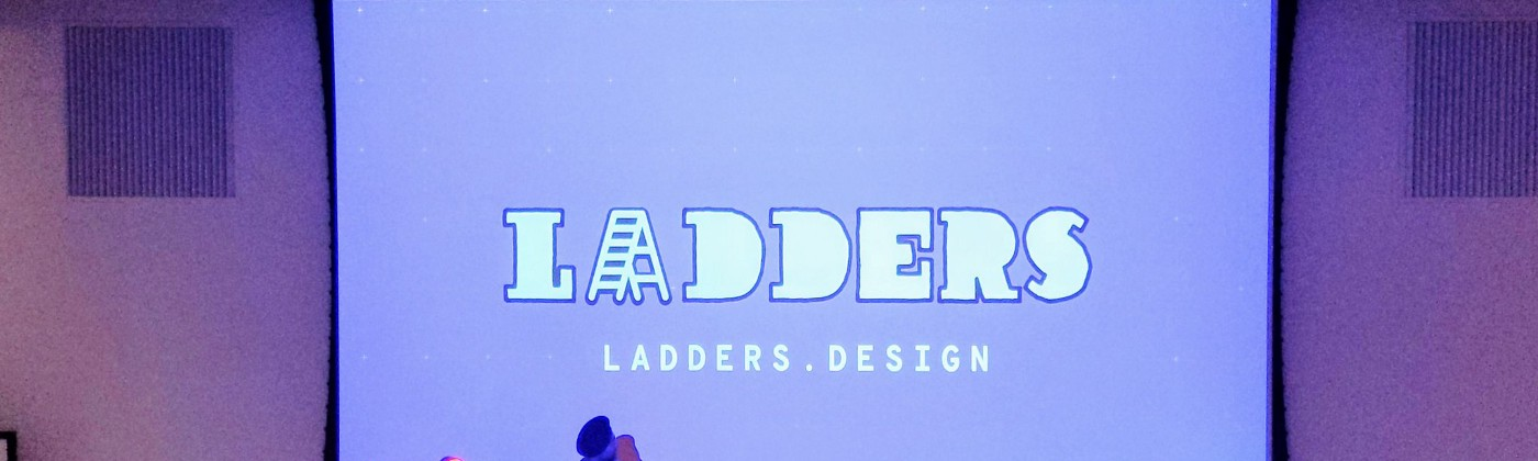 Preet Arjun Singh, host of the Ladders Conference, standing in front of a large screen displaying the conference name.