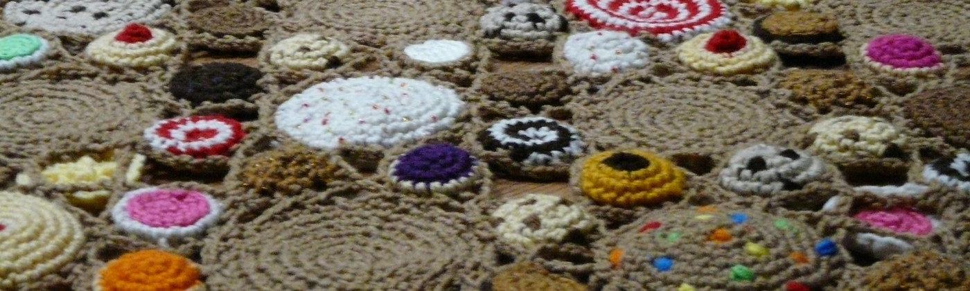 Detail of a crochet cookie afghan, with multiple, assorted crochet cookies
