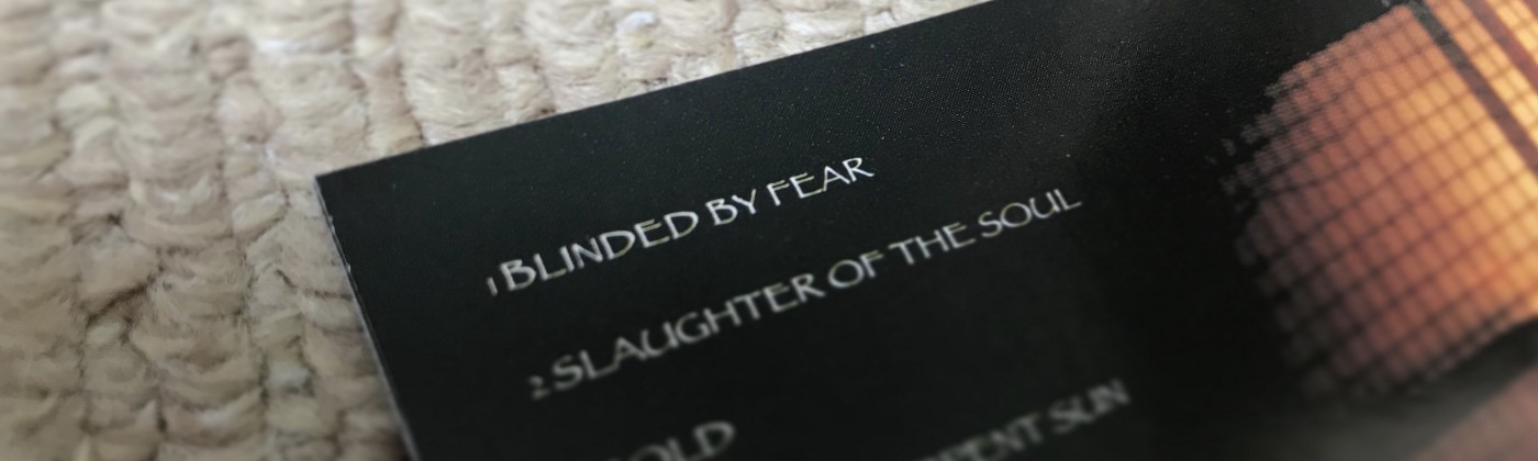 CD booklet featuring the song title 'Blinded by Fear'