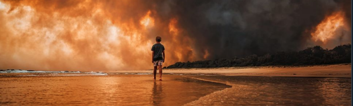 A child stands, watching his world burn. Taken during the Australian bushfires 2019