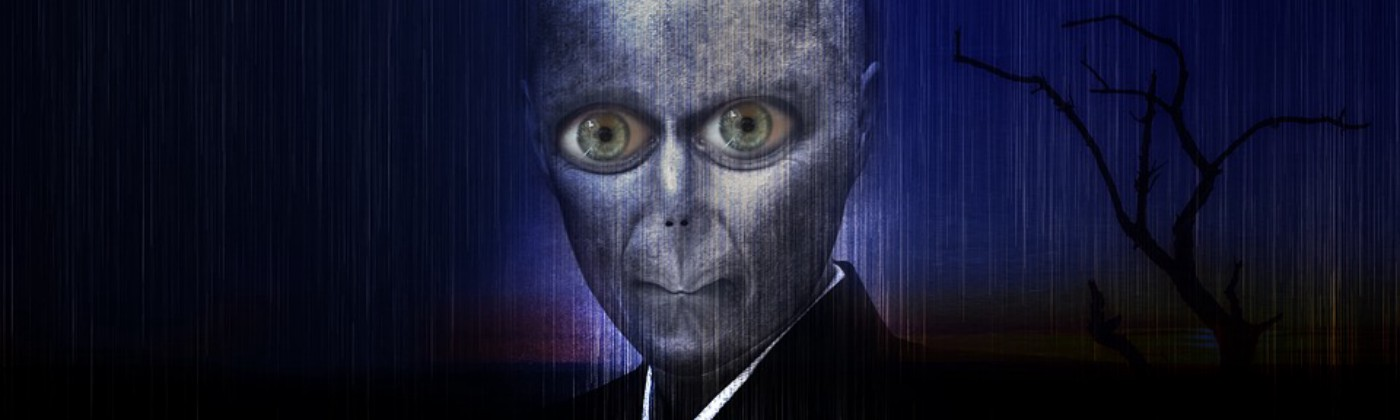 An alien or humanoid with green eyes in collared garment