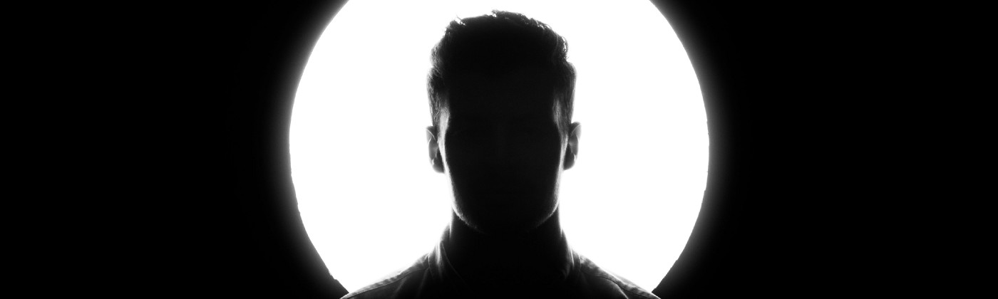Silhouette of a young man—Photo by Austin Distel on Unsplash